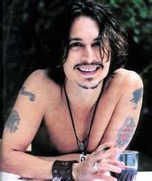 One of the rare photos you see Johnny Depp smile. ♥