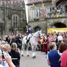 Dressage rider carrying the Olympic Torch to the Olympic games in London