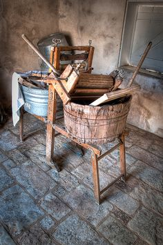 Laundry used to be done by hand by scrubbing the clothing against the washboard and hanging it to dry