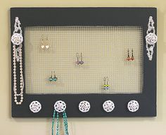 diy jewelry storage, I would use a cork board and just line the bottom with knobs. Then I would add a rope braid to the top to hold earings