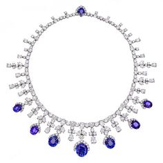 "Estate Harry Winston Sapphire & Diamond Fringe Necklace    Sapphire and diamond fringe necklace in platinum. Oval-cut natural sapphires weighing 41.93 total carats and circular-cut and pear-shaped diamonds weighing 74.58 total carats. Length: 15"" (38.1 cm). Signed Harry Winston. Of royal provenance."
