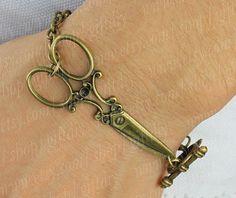 metal dog bone shaped claspCUFFBronze Scissor Bracelet  by giftdiy, $3.99