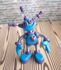 Commission: F.L.A.M.E. mini robot sculpture by HerArtSheLoves via thewesomerobots.com