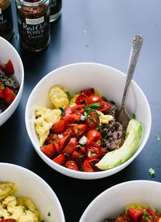 Delicious breakfast bowls made with scrambled eggs, black beans, pico de gallo and sliced avocado! http://cookieandkate.com