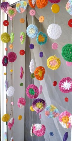 Crochet door curtain. Crochet circles out of scraps and add buttons and beads. Suspend from spring rod for curtains.