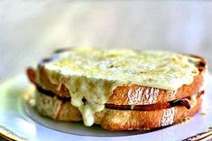 Class French Croque Monsieur recipe, toasted ham and Swiss cheese sandwich, topped with a bechamel sauce  of butter, flour, milk, nutmeg, Parmesan and Gruyere.