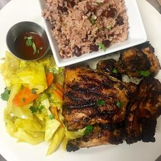 Friday Night at Irie Zulu means Jamaican Food. Here is a plate of our mouthwatering Ultimate Jerk Chicken served with a side of stir fry cabbage and rice n' peas #iriezulu #FridayNights #JamaicanFood by iriezulu