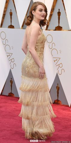 Was Oscar-winner Emma Stone's dress inspired by the actual trophy? She wore one of Riccardo Tisci's last designs before he stepped down from Givenchy, it exudes gilded era old-school glamour, just like La La Land.