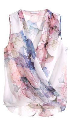 Love the soft watercolor print. Wish the blouse was longer though.