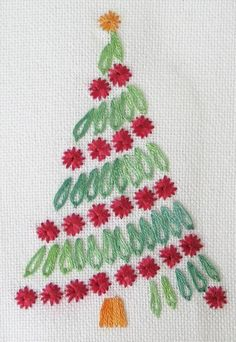 Embroidered Christmas Tree - Work this free Christmas embroidery pattern in basic surface embroidery stitches including detached chain (similar to lazy daisy), satin stitch and a basic eyelet stitch or Algerian eye.