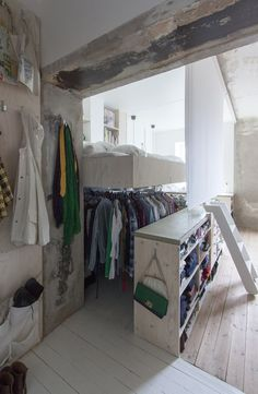 The wardrobe sits beneath the raised bed