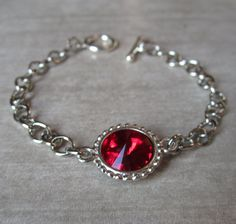 July Birthstone Bracelet, Silver Ruby Red, Swarovski Crystal Birthstone Jewelry, Red Ruby Bracelet. $30.00, via Etsy.
