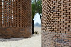 Orient Occident Atelier builds Cambodian community hall that harvests drinking water Hong Kong Architecture, Effects Of Global Warming, Brick Construction, Water Sources, Lake Water, Small Buildings, Metal Roof, Drinking Water, Atelier