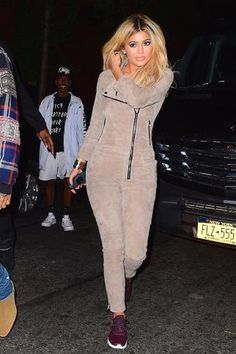 Kylie Jenner wearing Cartier Love Bracelet, Annex Quad Lock Iphone Case, Nike Air Max Thea Sneakers in Maroon and RTA Zou Zou Suede Jumpsuit Colored in Trooper