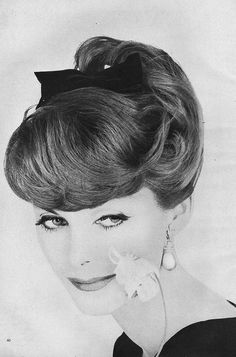 A sweetly beautiful bow adorned updo from 1957. #vintage #hair #1950s