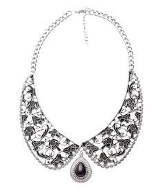 Dangling Pearl Necklace is one of a kind and can be very well clubbed with saree's and other Ethnic wear.