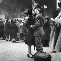 Couple in Penn Station sharing farewell kiss before he ships off to war during WWII . Photo by Alfred Eisenstaedt