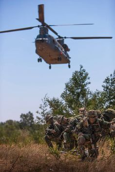 Members of 11 (NLD) Airmobile Brigade await landing of CH-47 Chinook during Hot Blade 2014, Ovar, Portugal.