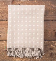 Pure new lambswool bone and white double sided spot check throw. Super soft and finished with rolled fringe Product Code: 3479/P14