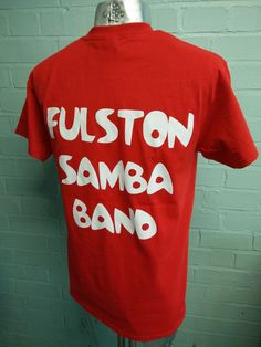 Printed t-shirts for Fulston Manor Samba Band and Fulston Manor Dance Company. The samba t-shirts are red with custom logo and custom print on the front. Dance company t-shirts are black with custom logo with custom print.