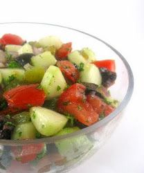 Israeli salad: A great way to use some of that mint growing out back.  Diced tomatoes and Cucumbers, chopped mint, with lemon juice and olive oil. Mmmmm. You can add red onion too if you like.  A great cool and refreshing salad!