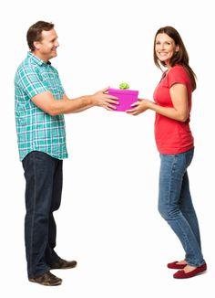 Imagen libre de derechos: Wife Smiling While Receiving a Gift…