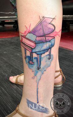 Watercolor piano tattoo