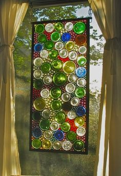 Stained glass from bottle bottoms - I would LOVE to try this project some day.