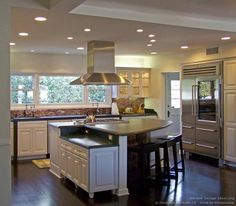 Luxury White Kitchen with a Large Island and Pearlescent Backsplash - Designer Kitchens LA