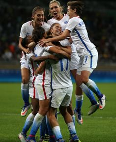 The U.S. women celebrate after Carli Lloyd's game-winning goal vs. France, Aug. 6, 2016. (Eugenio Savio/AP)