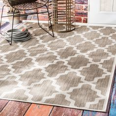 Inspired from Moroccan trellis patterns, this rug expands fashion for the outdoor decor featuring a new cut and loop pile construction, producing a unique design effect that gives your outdoor area that desired look.