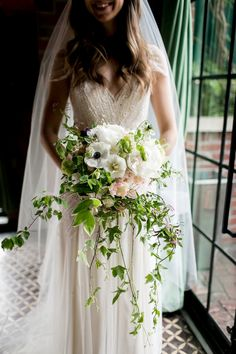 romantic cascading bouquet of peonies, anemones and tulips with jasmine and ivy by Sprout Home