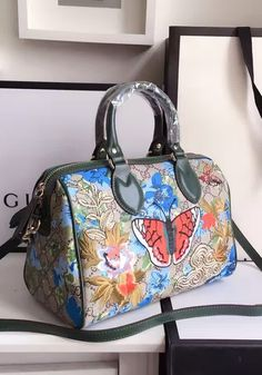Gucci GG Supreme top handle bag with embroideries and green leather trim.  Find Gucci purses at http://www.luxtime.su/gucci-bags