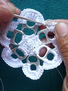 Crochet a Flower With Pull Tabs For crafters who want to know how to crochet with pull tabs, we've come up with this free crochet pattern that will teach you how to crochet a flower. This is our first DIY project and it's a good introduction to recycled crafts. This crochet flower can be made into a Christmas tree orna