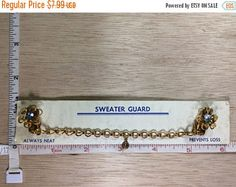 """20%OFF Super Sale Vintage 4.5"""" Gold Toned Flower Sweater Clip Blue Rhinestone Used"""