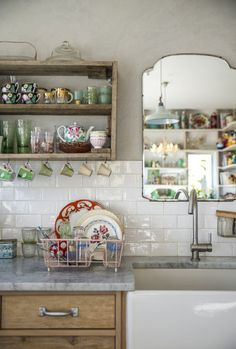 pureblyss:  open shelves. farmhouse sink. granite countertops. pretty dishes. I'm in love.
