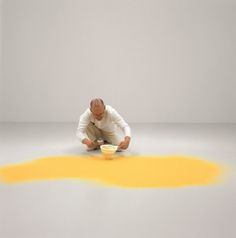 Wolfgang Laib at the MoMA.   The artist sifting pollen from hazelnut, 2003.