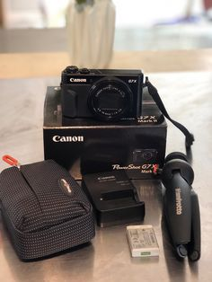 Bought it a month ago. Barely used. Reason for selling I got a new camera that I prefer for my work. Comes with Tripod, extra memory card, charger, SD card 32 GB and a case I bought with it. And a warranty protection plan. Canon G7x Camera, Canon Lens, Canon G7x Mark Ii, Canon Eos Rebel, Iphone Accessories, Video Camera, Cool Things To Buy, Stuff To Buy, Sd Card