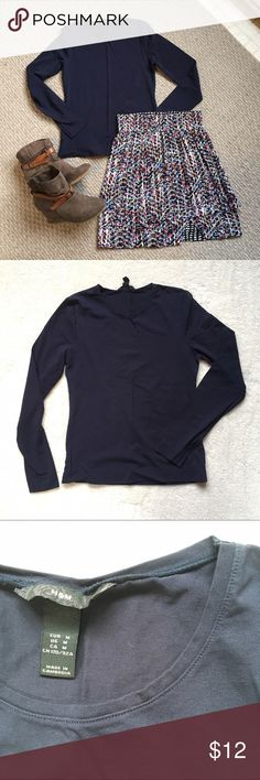 H&M navy blue long sleeve crew neck H&M navy blue crew neck long sleeve top. 95% cotton and 5% elastane giving it a stretchy, fitted, comfortable style. Great for all purposes - under a blazer, tucked into a skirt, or casual with leggings & boots. No tags, new condition. H&M Tops Tees - Long Sleeve