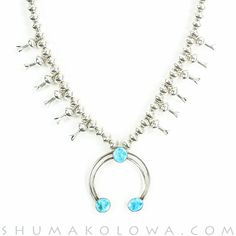 Master Navajo silversmiths handcrafted this stunning and iconic squash blossom necklace. One of the most recognized necklace silhouettes in the world, the squash blossom necklace is the culmination of