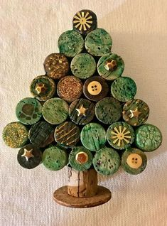 "CORK THERAPY wine cork Christmas Tree. This 7"" x 5"" tree will look great sitting on your mantle or desk at work during the holiday season, or would be a perfect gift from your secret Santa! Each of these trees are unique, using different corks and embellishments. The corks are dyed prior to assembly to give them a more natural look, verses using paint like other sellers do. So the tree you receive will be slightly different that the picture. XX50 #winecorkcrafts"