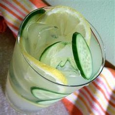 "Cucumber Punch | ""This cool, refreshing punch is made with white grape juice, lemonade mix, and cucumbers. Garnish with thin-sliced lemons and cucumbers."""