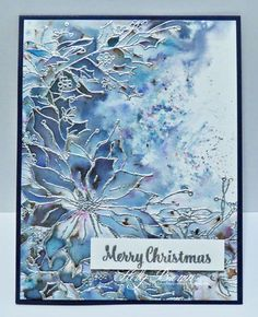 This started out as an experiment and I loved it so much, I repeated it with other colors of embossing powders and Infusions watercolor powders. I started by embossing the poinsettia image onto hot press watercolor paper, and then I sprinkled the watercolor powders over the paper. Some light misting of water over it is all it takes for this explosion of color to appear.