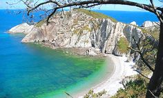 Playa del Silencio, Asturias, Spain. A Spanish article about the lack of dog beaches in Asturias, instead they have given information on a secluded, difficult to reach beach. I love kayaking to beaches like this. Bliss