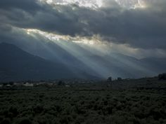 Behind rays of light