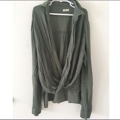 Draped Olive Green Blouse A draped front olive green blouse that criss crosses in the front. Has button details on the sleeves. Only worn twice, I just need a size up otherwise I would keep it! I bundle, just ask or use the bundle feature!  Hollister Tops Blouses