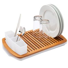 "Slat Bamboo Dish Rack by Umbra ($29.99) 19"" x 12"" x 2""H - can accommodate up to 16 plates; built-in utensil caddy holds flatware; slanted tray ensures water drains directly into sink; base is made from food-grade polypropylene"