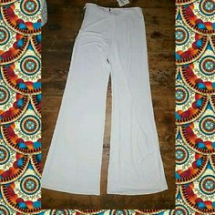 Jean Paul Gaultier FEMME Drapey White Rayon Pants BNWT auth JEAN PAUL GAULTIER FEMME Drapey flare/wide leg 100% Rayon side zip UNLINED SEMI SHEER pants FITTED WAISTBAND Msrp  $595 (store from where purchased wrote $ on tag SZ IT 40 (US 6 as per tag, pls see pic pls visit designer website for SIZE GUIDE)  *SORRY PIX SUCK WILL B TAKING BETTER 1s ASA ABLE & SWITCH OUT & MEASURE  these pants are white, unlined , 100 rayon so goes to reason. They are semi sheer to really sheer in areas…