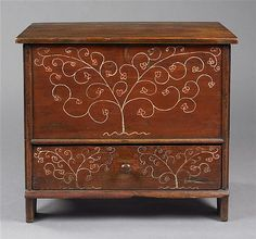 Keno Auctions. 1/18/11. Lot 156.  DIMINUTIVE PAINT-DECORATED PINE BLANKET CHEST Attributed to Robert Crosman (1707-1799).  Taunton, Mass., ca 1726.  Hinged top is a 19th century replacement. h. 20 1/2 in., w. 22 1/4 in., d. 12 3/4 in.  Provenance: Esther Stevens Frazer who died in 1945; Historical Society of Early American Decoration; purchased from the Historical Society very shortly after it closed its museum in Albany, NY; Owned by consignors since September 1990.