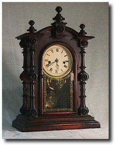 """Welch """"Patti V.P."""" Mantel Clock, Circa 1875. This is a Welch , Spring and Co. """" Patti V.P. """" with an 8 day """" Patti """" type movement. The beautiful rosewood case still has its original finish and a great label. Also the  fancy blue and white sandwich glass pendulum with gold leaf decoration on the glass. One of the most collectible shelf clocks of the Victorian period. The dimensions of this clock are 19 """" x 12 """" x 6 """"."""